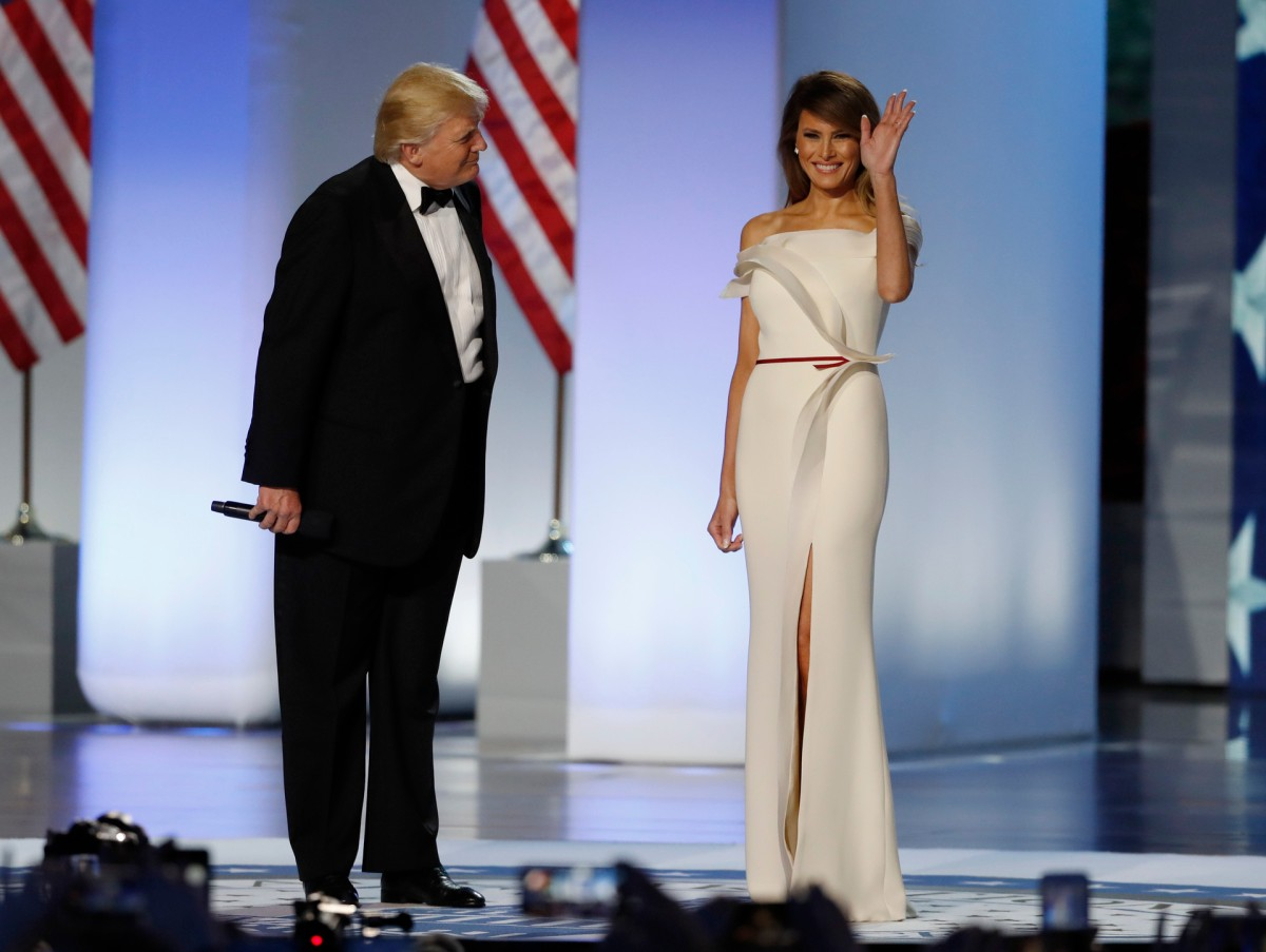 U.S. President Donald Trump introduces his wife, first lady Melania Trump, as they arrive at the Inauguration Freedom Ball in Washington